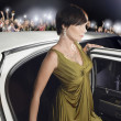 Woman getting out of limousine — Stock Photo #33841121