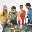 Friends Gambling on roulette table — Stock Photo #33841591