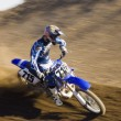 Постер, плакат: Motocross racer on track