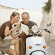 Couple Reading Map — Stock Photo #33841771
