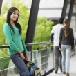 Stock Photo: Teenage girl leaning against railing