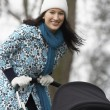 Mother walking with baby carriage  — Stock Photo