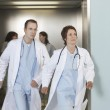 Doctors running out of elevator — Stock Photo #33842039
