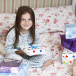 Girl with christmas presents — Stock Photo #33842107