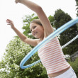Girl with hula hoop — Stock Photo