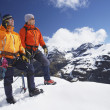 Climbers on snowy peak — Stock Photo