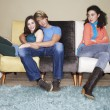 Third wheel sitting arms crossed — Stock Photo #33842441