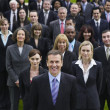 Business people standing on lawn — Stock Photo #33842527