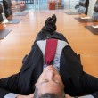 Businessman lying on conference table — Stock Photo #33842613