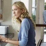 Woman using laptop looking worried — Stock Photo #33842631