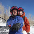 Couple sitting on snowmobile — Stock Photo