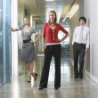 Businesspeople in office corridor — Stock Photo
