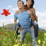 Couple in mountain meadow — Stock Photo