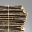 Bundle of corrugated cardboard — Stock Photo #33844403