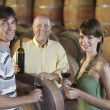 Winemaker Pouring Glass of Wine — Stock Photo #33844447