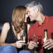 Couple with champagne flutes rubbing noses — Stock Photo #33844511