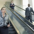 Businesspeople on escalators — Stock Photo #33844789