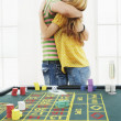 Man hugging woman at roulette table — Stock Photo #33844895