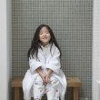 Young Girl wearing bathrobe — Stock Photo #33845115