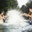 Couple splashing water — Stock Photo