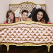 Teenage Girls on funky cushion bed — Stock Photo #33845193