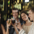 Two young couples toasting drinks — Stock Photo