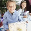 Brother and sister with gifts — Stock Photo #33845313