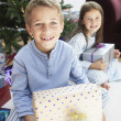 Stock Photo: Brother and sister with gifts