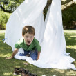 Stock Photo: Boy in back yard