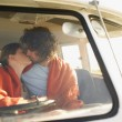 Couple kissing in front seat of van — Stock Photo #33845447