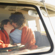 Couple kissing in front seat of van — Stock Photo