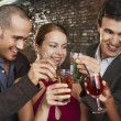 Two couples toasting standing in bar — Stock Photo