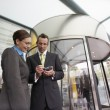 Businessman showing businesswoman PDA — Stock Photo #33845591