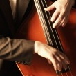 Hands on double bass — Stock Photo