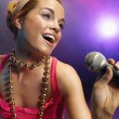 Woman Singing on stage — Stock Photo