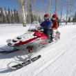 Couple driving snowmobile — Stock Photo #33846421
