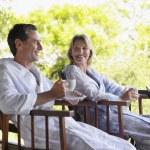 Couple sitting on terrace — Stock Photo #33846993