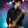 Rock Guitarist on stage — Stock Photo #33847011