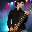 Stock Photo: Rock Guitarist on stage