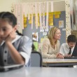 Teacher sitting with student — Stock Photo