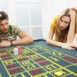 Man and woman losing on roulette table — Stock Photo