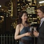 Elegant couple with champagne flutes — Stock Photo #33848157