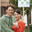 Couple in front of new home — Stock Photo