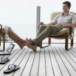 Stock Photo: Couple relaxing on porch.
