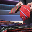 Businessman selecting ties in clothes store — Stock Photo