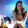 Woman sitting at bar — Stock Photo