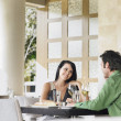 Stock Photo: Couple talking at restaurant