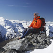 Climber using laptop on mountain — Stock fotografie #33848655