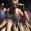 Male rock star singing — Stock Photo