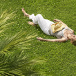 Stock Photo: Womsleeping on grass